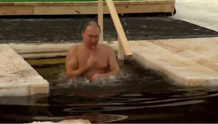 Russian President Vladimir Putin submerges himself in icy water Epiphany