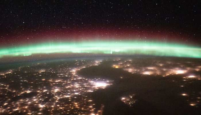 Iss shares earth photo surrounded with shining stars in the space