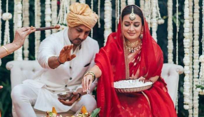 Dia Mirza wedding inside photos Dia Mirza signing documents to jaimala photos