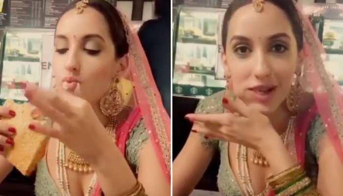 Nora Fatehi ने दुल्हन बनकर लिया चीज सैंडविच का लुत्फ, कैमरा देख दिया ये रिएक्शन