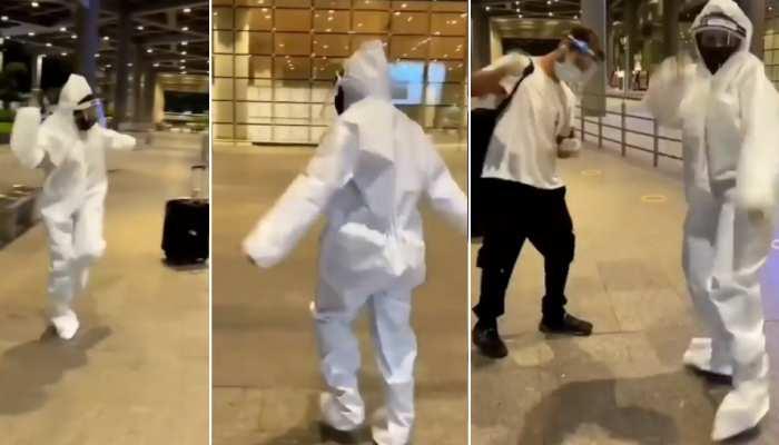 एयरपोर्ट पर PPE किट पहन पत्नी ने किया धमाकेदार डांस, देखता रह गया पति- देखें मजेदार Video