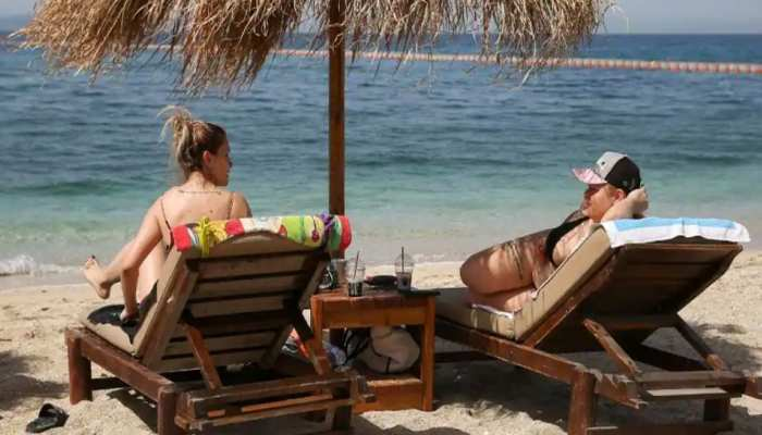 hoping to lure back tourists again as in greece reopens beaches after lockdown