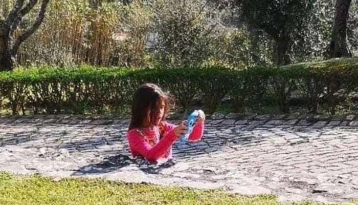 USA: Internet baffled by photo of girl seemingly stuck in sidewalk