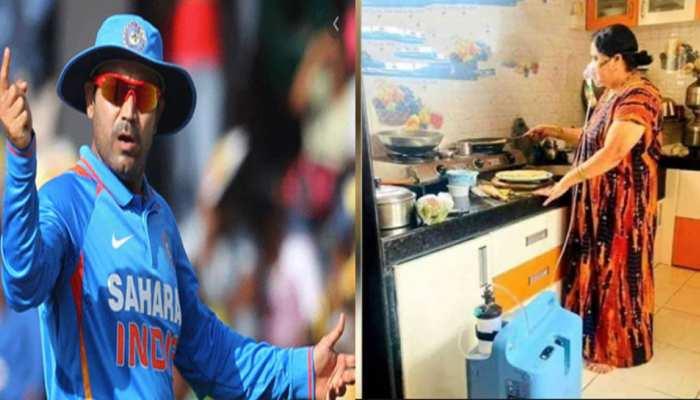 ऑक्सीजन सिलेंडर लगाकर खाना बना रही महिला को देख इमोशनल हुए Virender Sehwag, फिर जीता सबका दिल