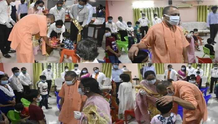 कोरोना महामारी में अनाथ हुए बच्चों से मिले CM योगी, गिफ्ट देकर बोले- चिंता मत करो, मैं हूं ना