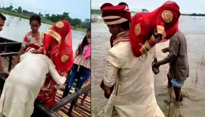 नदी में फंस गई दुल्हन, फिर दूल्हे ने कंधे पर बैठाकर यूं पार कराया; देखें Video
