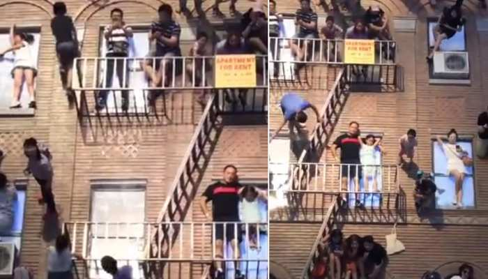 Are people standing or lying on this building? You will be confused by  watching the video   इस बिल्डिंग पर लोग खड़े हैं या फिर लेटे? Video देखकर  कंफ्यूज हो जाएंगे आप  