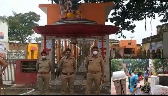 सीतापुर में सावन के पहले सोमवार पर जिले के सभी मंदिर बंद, भक्तों ने मंदिर के गेट पर ही चढ़ाए बेलपत्र और प्रसाद