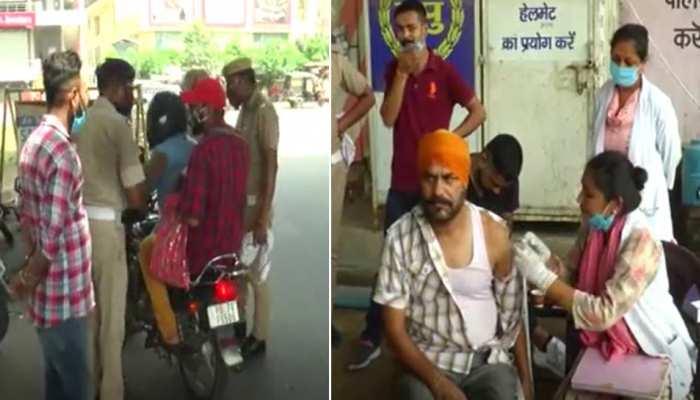 हरियाणा में मेगा वैक्सिनेशन ड्राइव, सड़क पर पुलिस नाके लगाकर लोगों को दी गई वैक्सीन