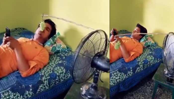 आलस की हद! हाथ लगाकर खाना ना पड़े, इसलिए शख्स ने लगाया ऐसा Desi Jugaad- देखें Video